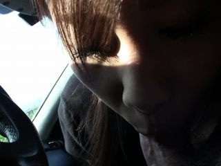 Cute Asian brunette teen fingered limitation blowing in the car