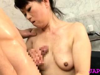 Fabulous older japanese nurse gets her large mounds felt up